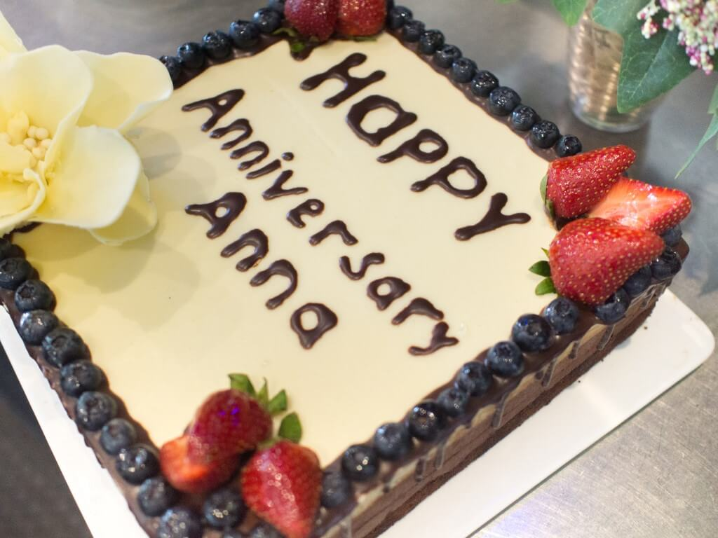 Anniversary cake with strawberry, blueberry and white chocolate toppings