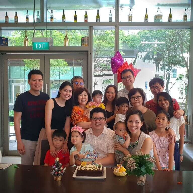 Family and friends celebrating birthday at restaurant