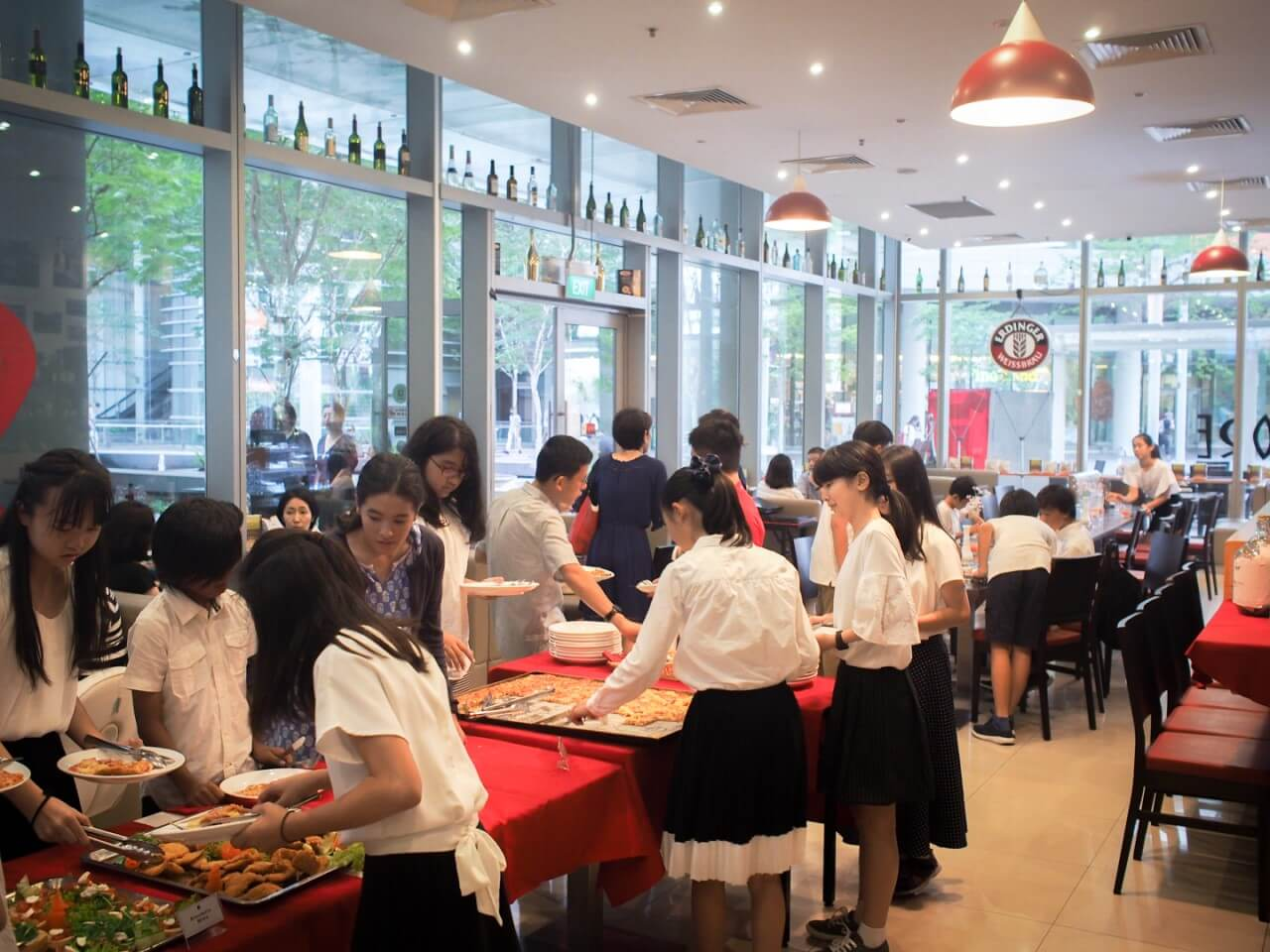 Group of students taking food from buffet spread