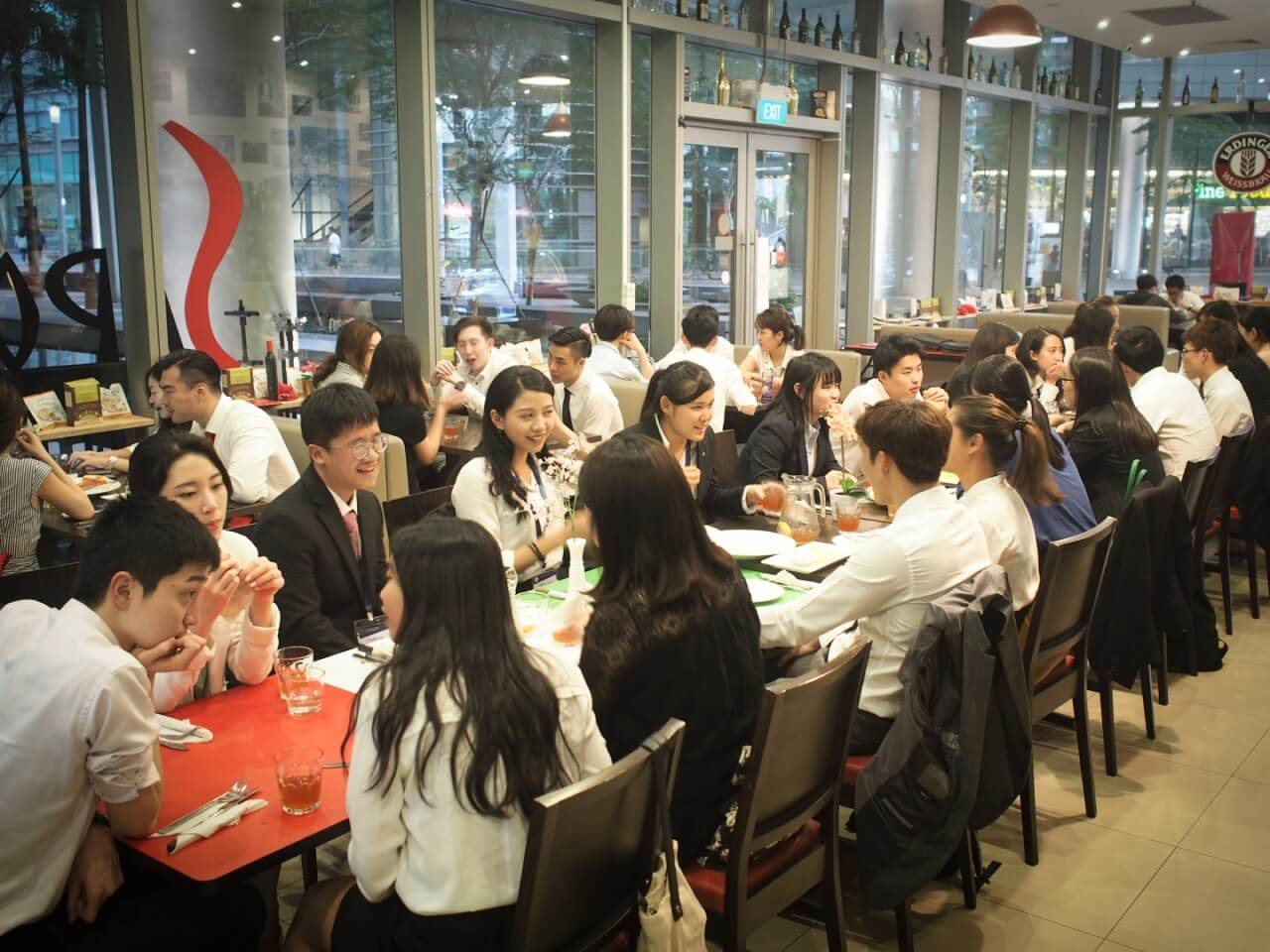 Group of students eating and talking at a restaurant